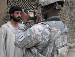 A US Army soldier capturing an iris image with the Handheld Interagency Identity Detection Equipment (HIIDE)