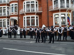 Police watch Julian Assange protest outside the Ecuadorian embassy in London (Photo credit: Chris Harvey/Shutterstock.com)