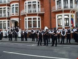 Police watch Julian Assange protest outside the Ecuadorian embassy in London (Photo credit: Chris Harvey/Shutterstock.com)