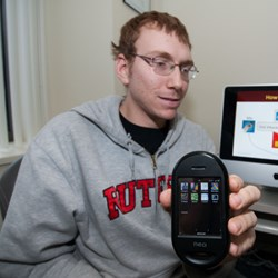 Computer science graduate student Jeffrey Bickford with smart phone used to test malicious software (Photo: Carl Blesch, Rutgers University)